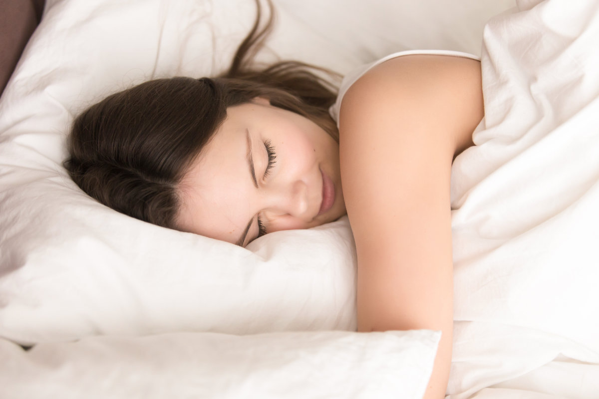 woman sleeping peacefully in clean soft bed